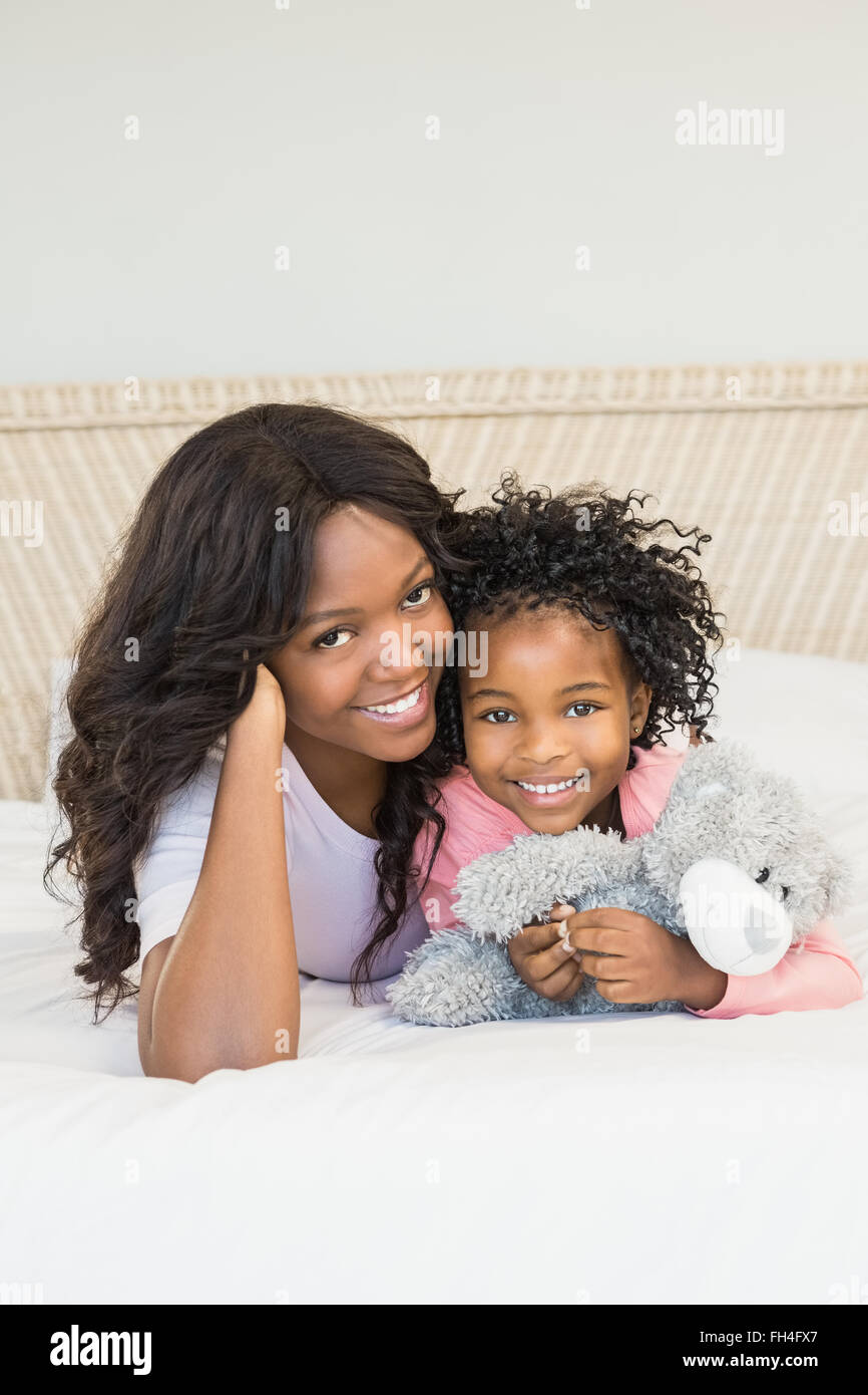 Mother and daughter smiling - Stock Image