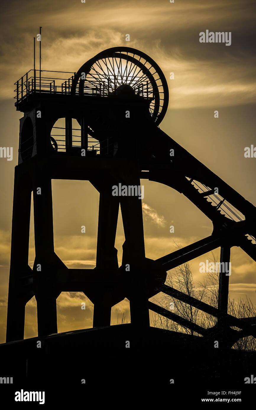 silhouette of old coal mine headstocks Stock Photo