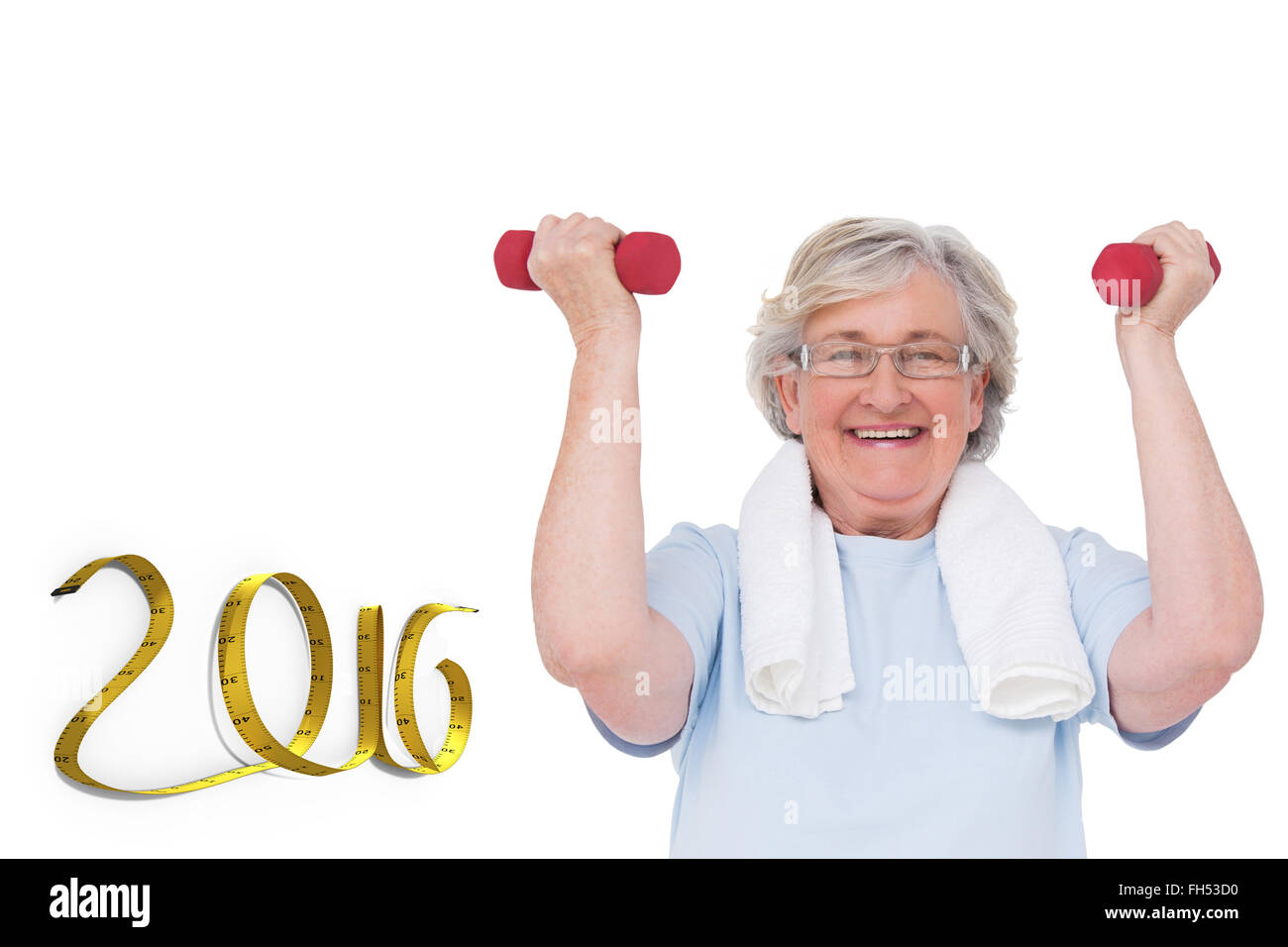 Composite image of senior woman lifting hand weights - Stock Image