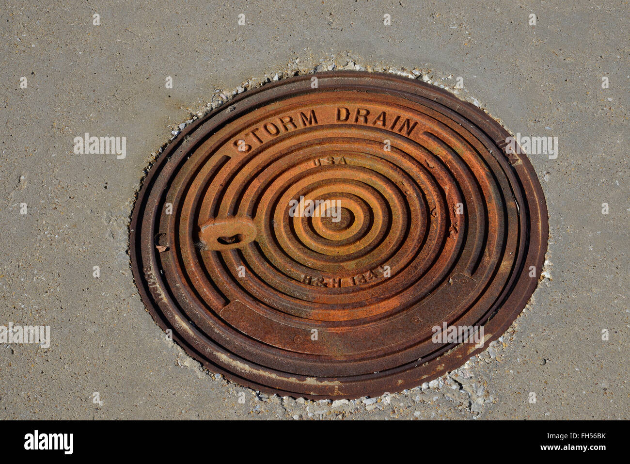Sewer lids, utility access, drain covers, water meter access - Stock Image