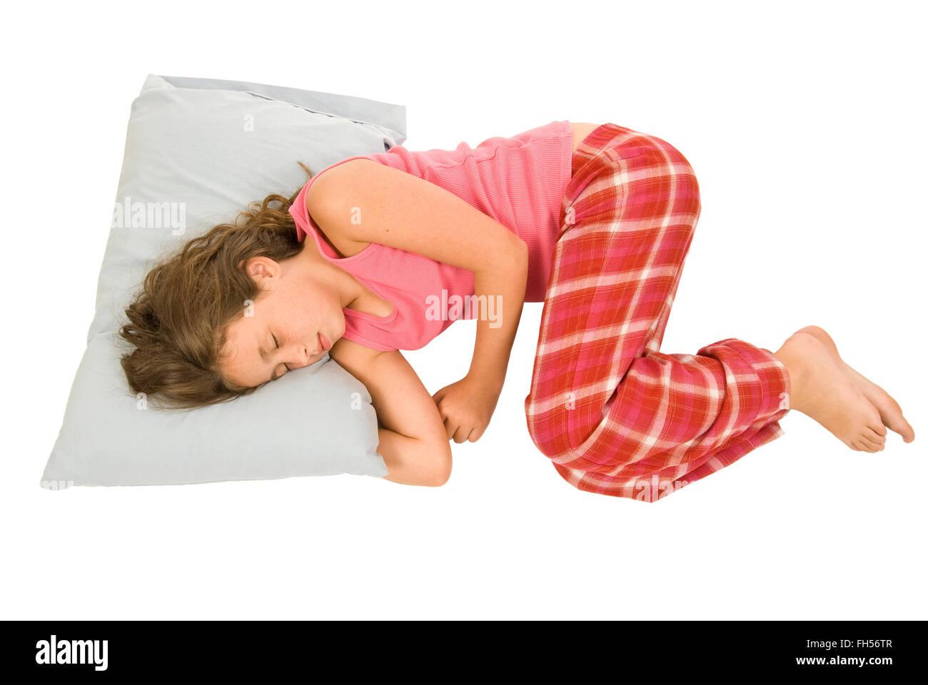 Little Girl Sleeping In Fetal Position - Stock Image