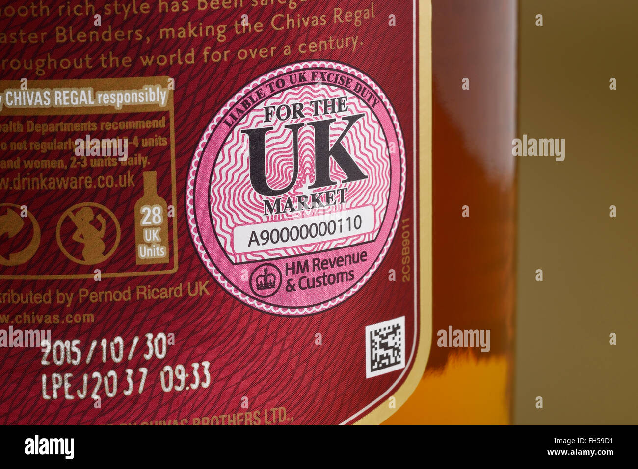 Close up of the UK HM Revenue and Customs Excise Duty seal on a bottle of whisky - Stock Image
