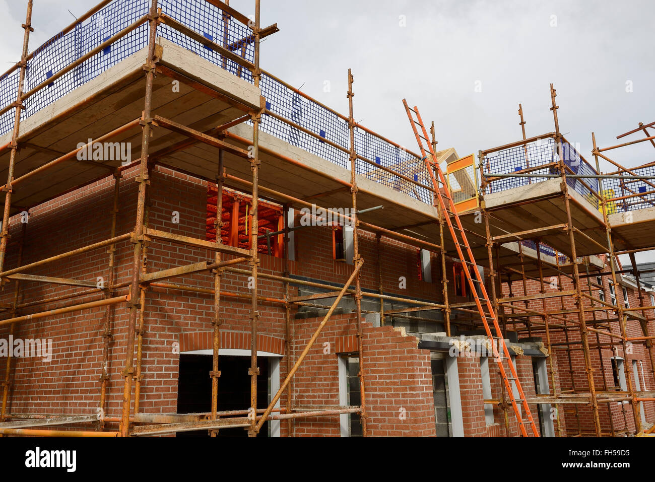 Scaffolding on a partially completed new build house on a UK building site Stock Photo