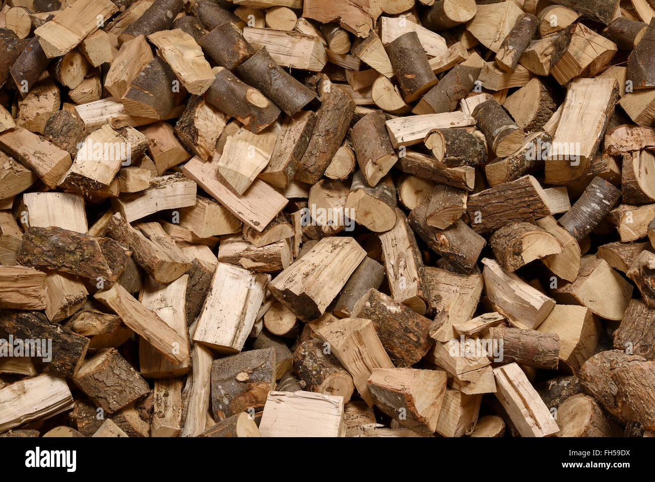 Abstract background of chopped wood logs - Stock Image