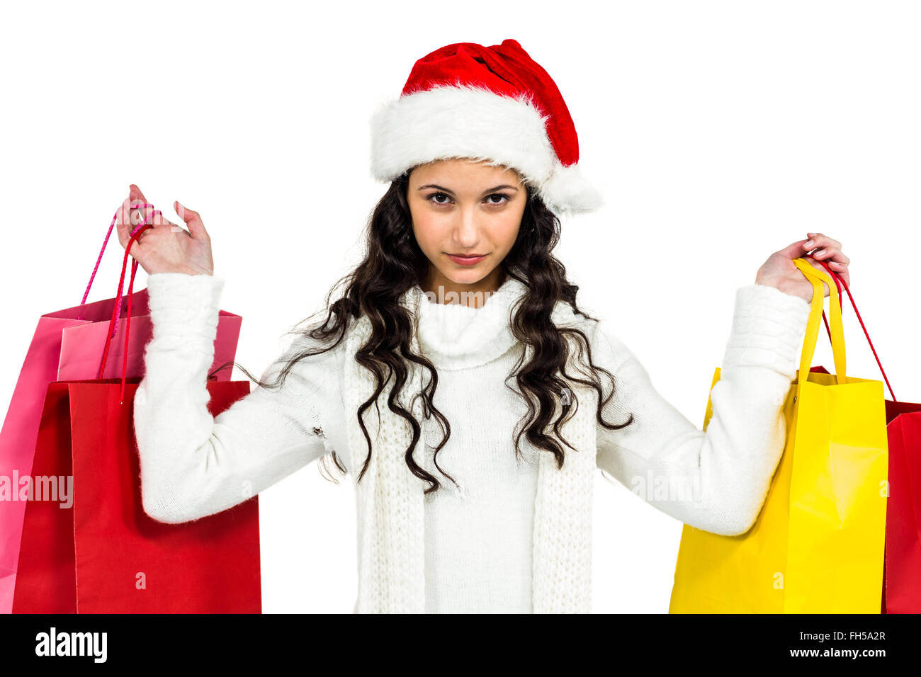 453f78c53c468 Woman with christmas hat holding colored shopping bags Stock Photo ...