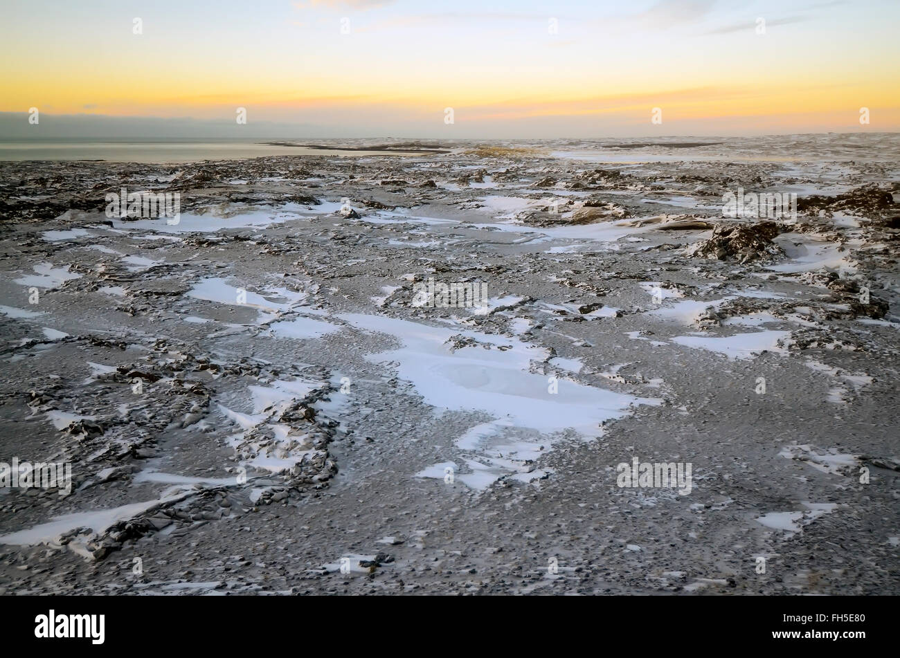 Reykjanes Peninsula Iceland Winter scene  of  desolate black and white lava fields with color sky - Stock Image