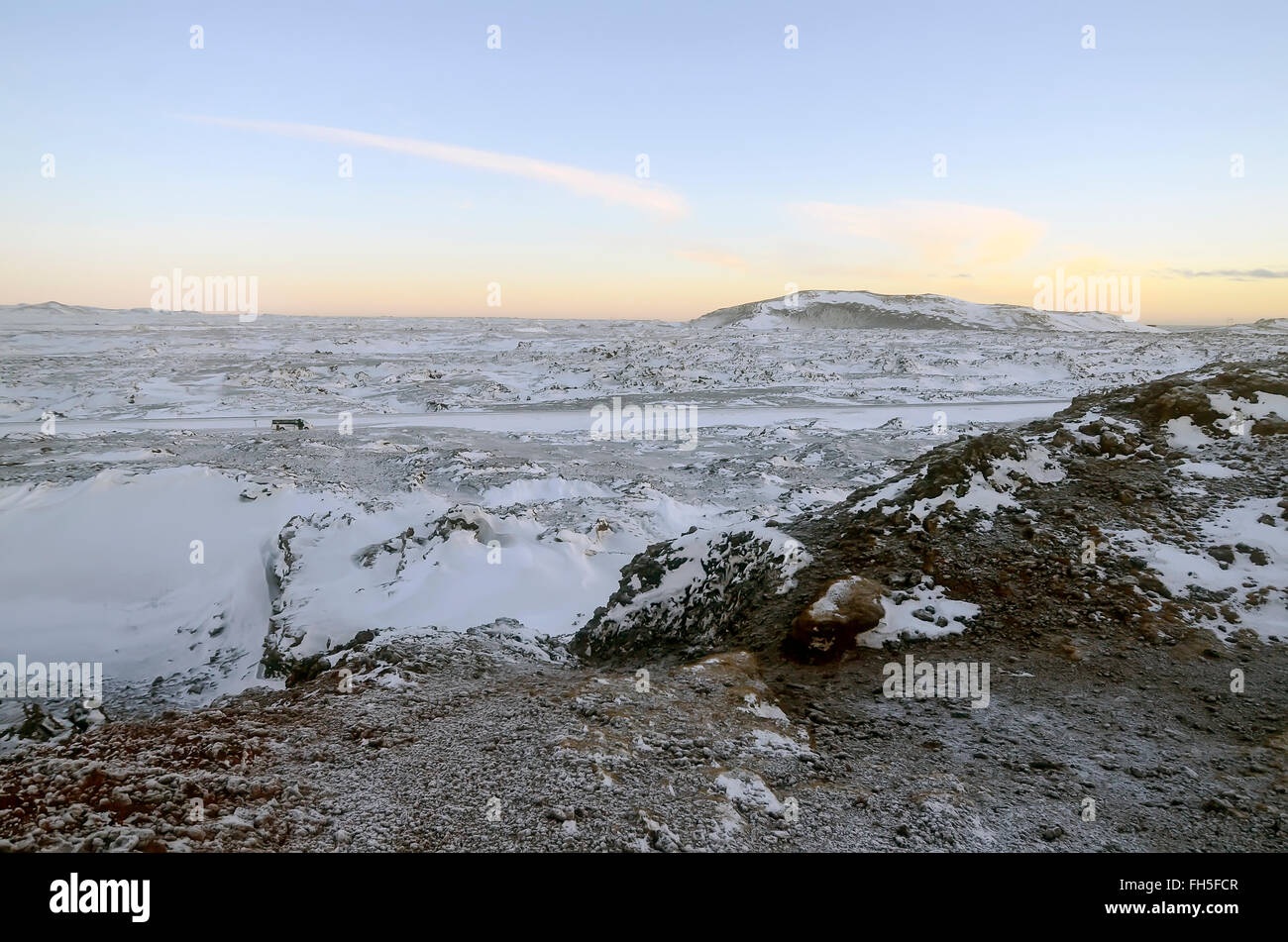 Winter black and white volcanic landscape contrast with color sky Reykjanes Peninsula, Iceland - Stock Image