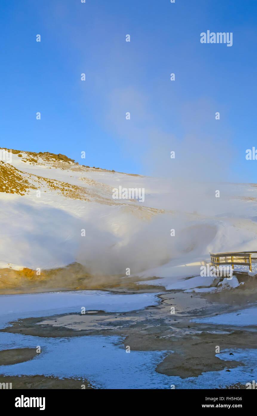 Krýsuvík geothermal area boiling hot spring steam, smoke boardwalk winter Reykjanes Peninsula Iceland - Stock Image