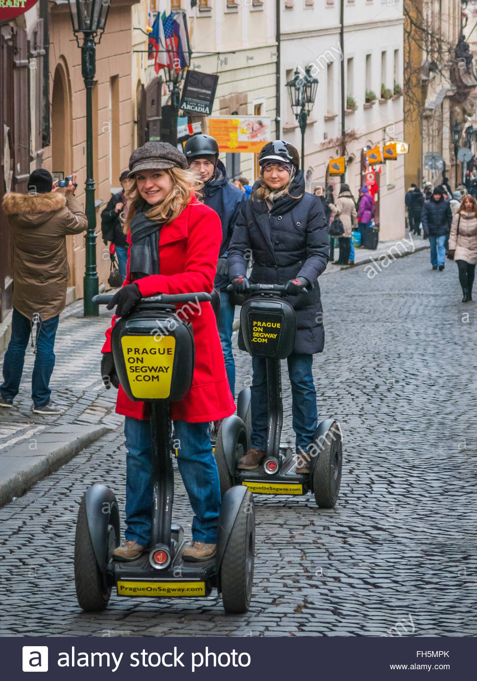 Prague, Czech Republic - 2 January 2014:  Woman tour guide leads tourists on a Segway Tour around the cobbled streets - Stock Image