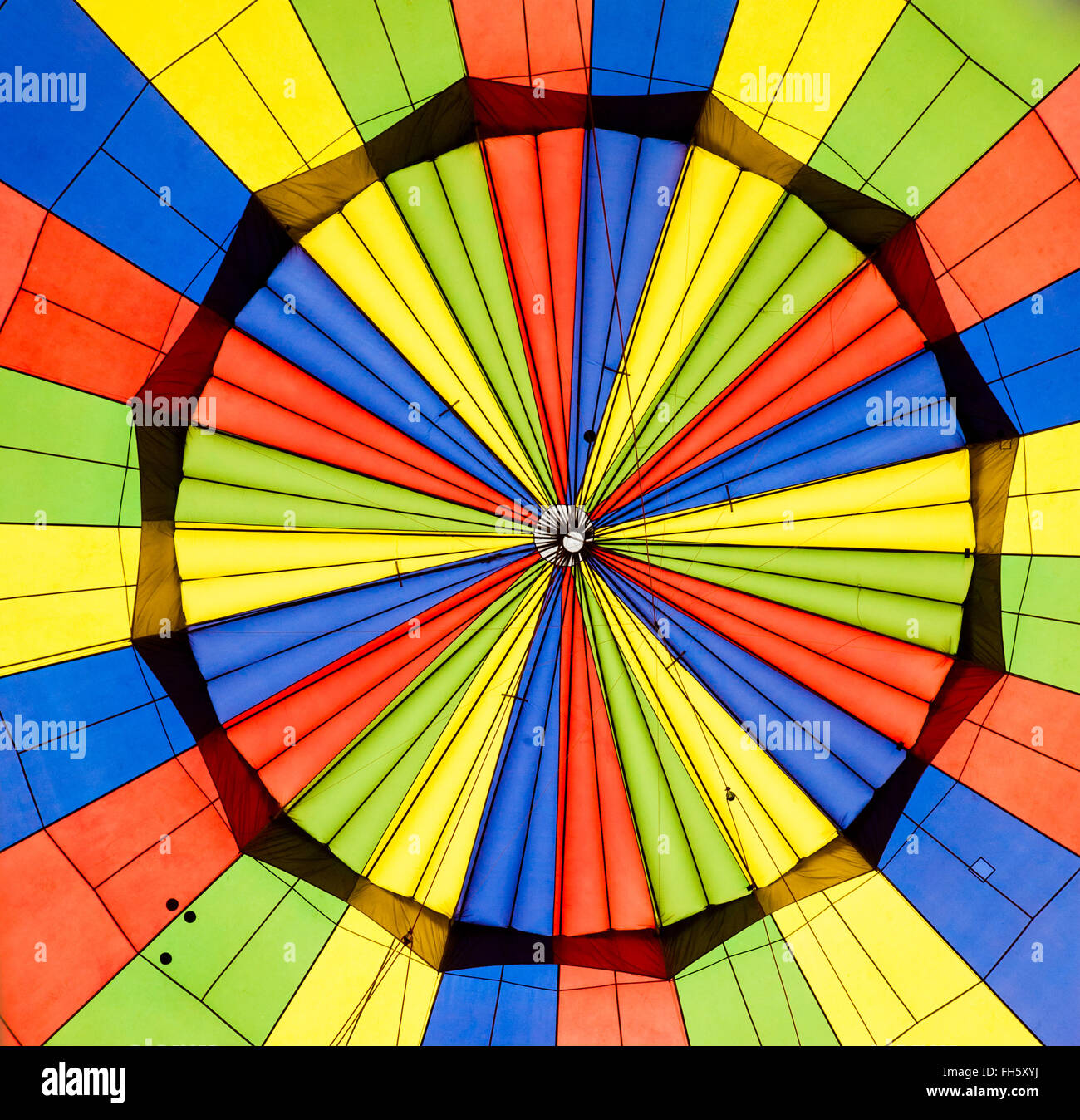 Apex of the interior of a hot air balloon in primary colours of rip stop nylon - Stock Image