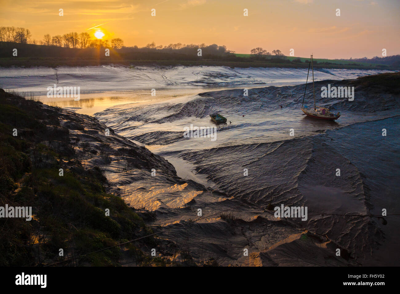 Sunset and low tide over the river Avon at Sea MIlls near Bristol UK Site of the Roman port of Abona - Stock Image