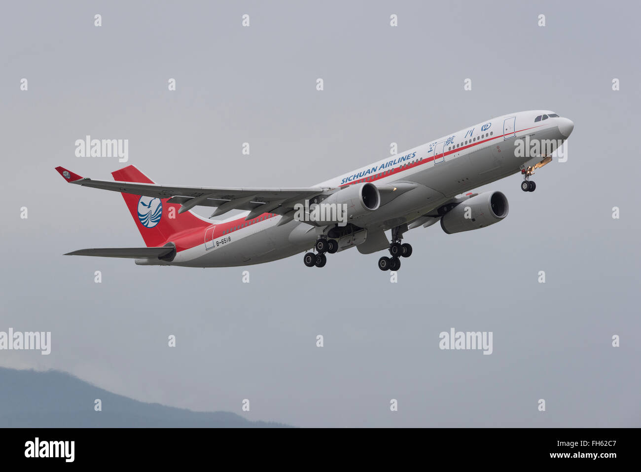 Sichuan Airlines Airbus A330-200 in air after taken off. - Stock Image