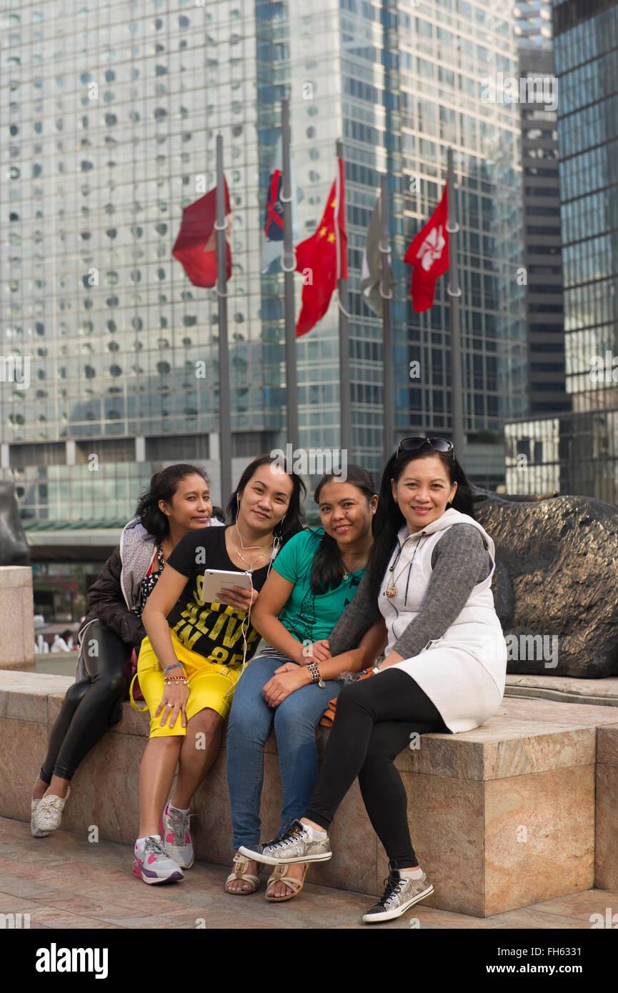 Filipino nannies posing, Hong Kong China - Stock Image
