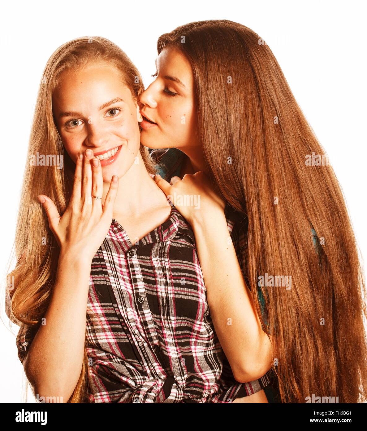 Two cute teens kissing
