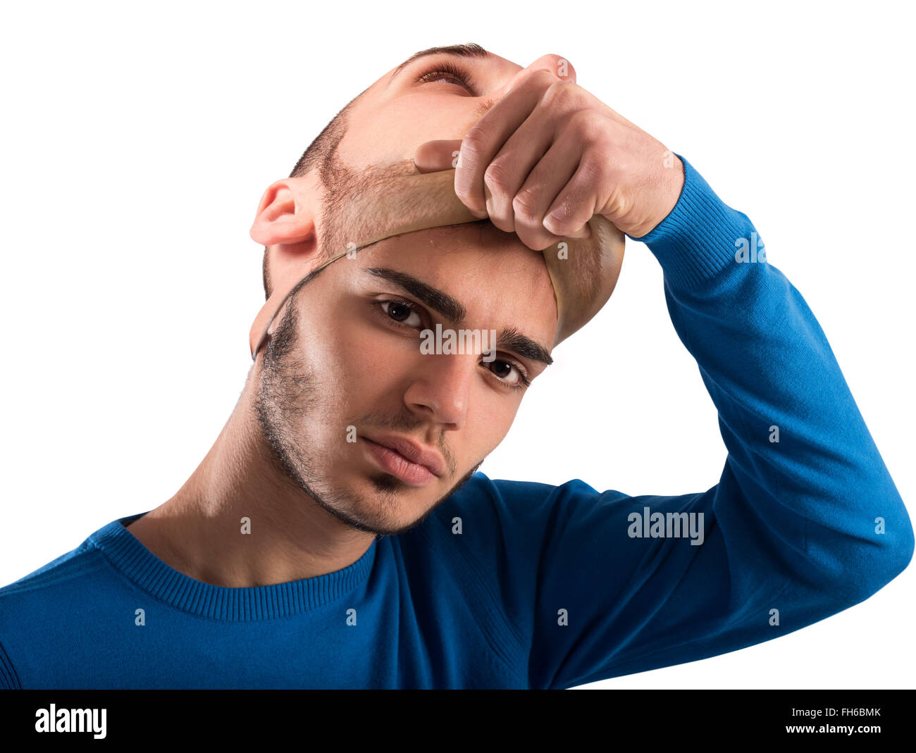 Teenager with adult mask - Stock Image