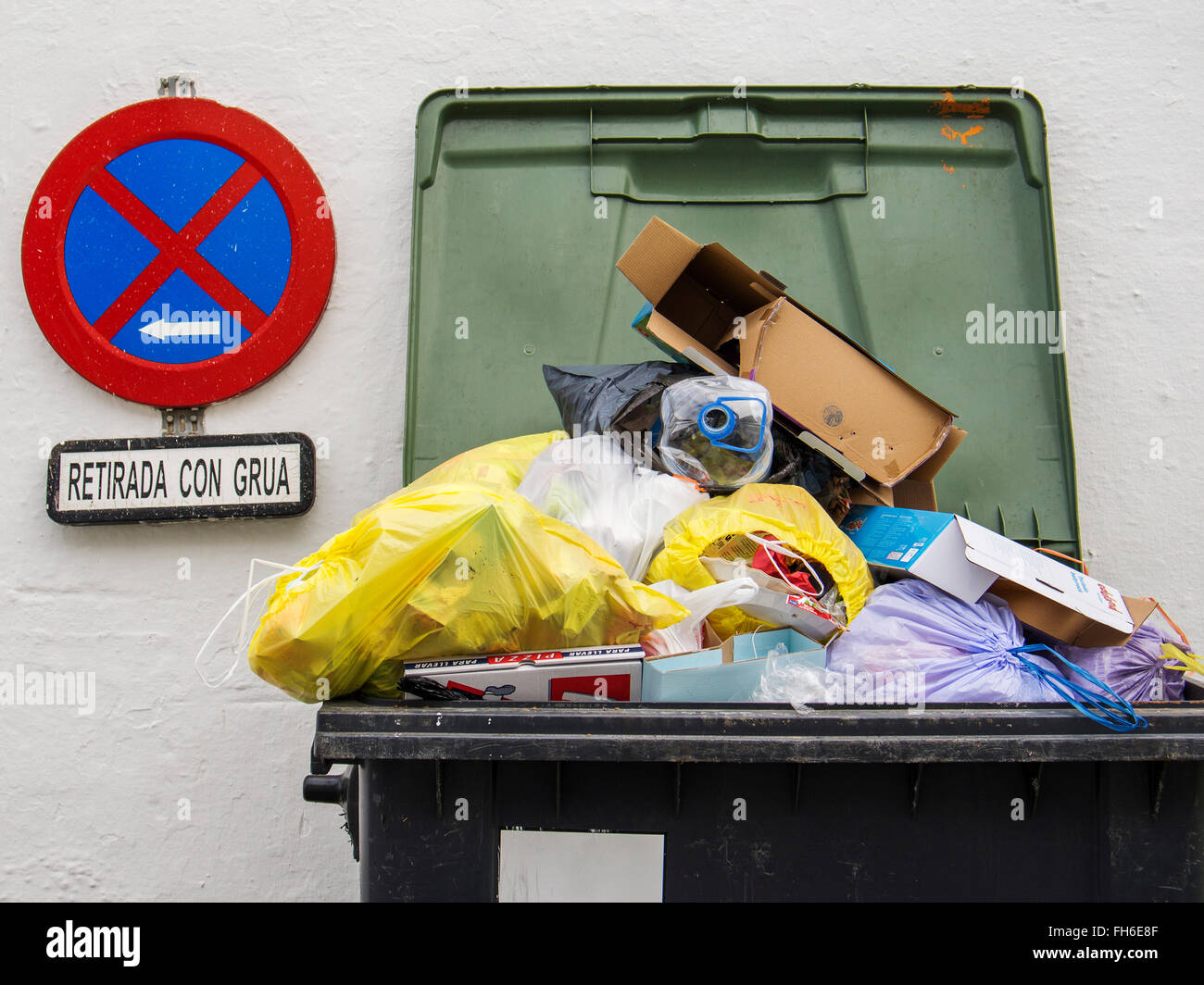 Overflowing Rubbish Bin Dumpster - Stock Image