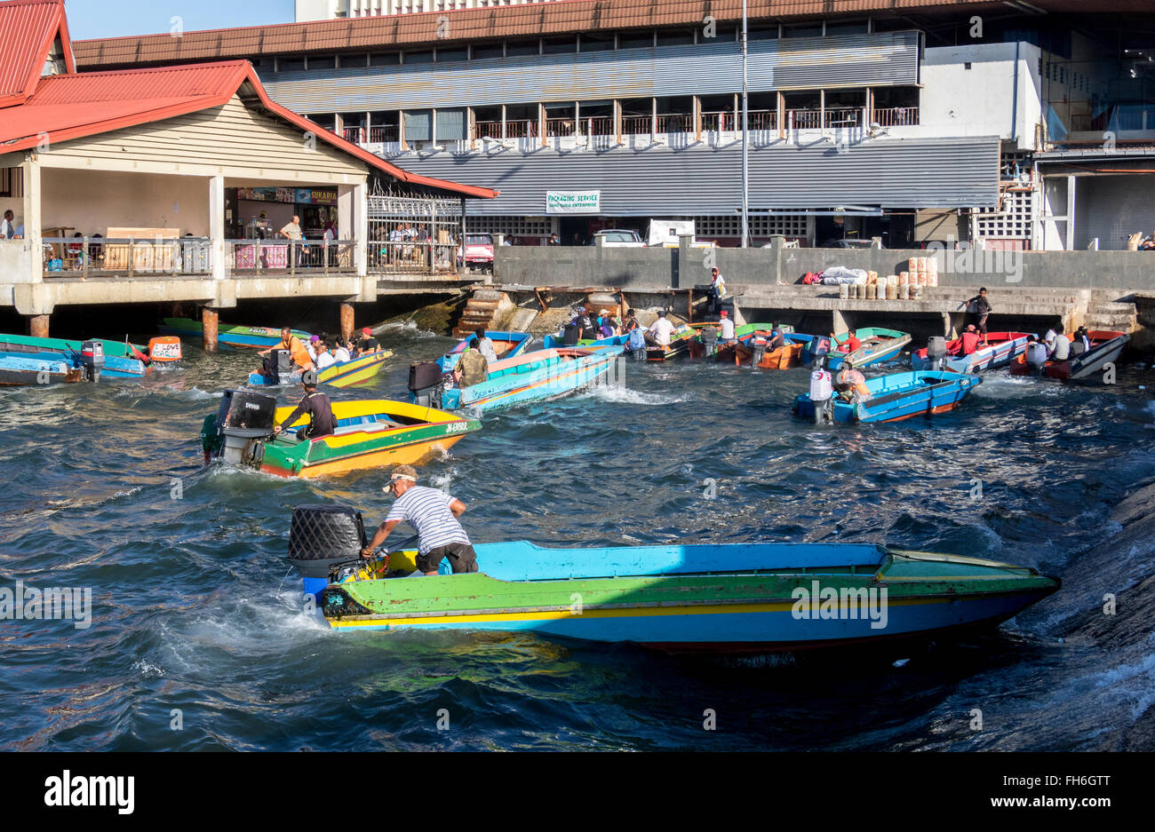 Boats going to and from the Island around Kota Kinabalu fish market Sabah Malaysia when the sea is rough on otherwise - Stock Image