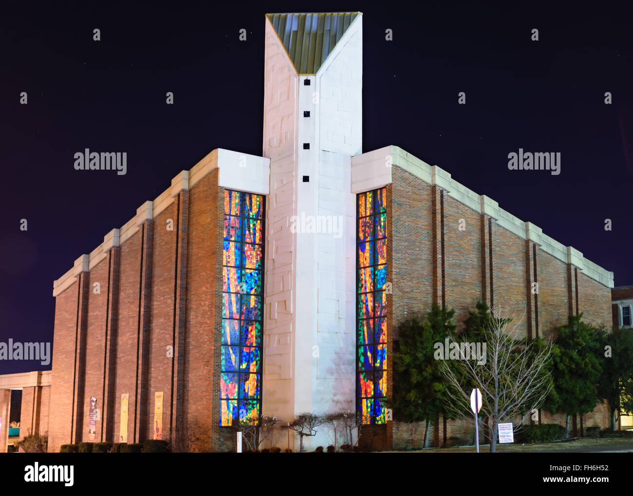Church exterior with illuminated stained glass in Muskogee, Oklahoma Stock Photo