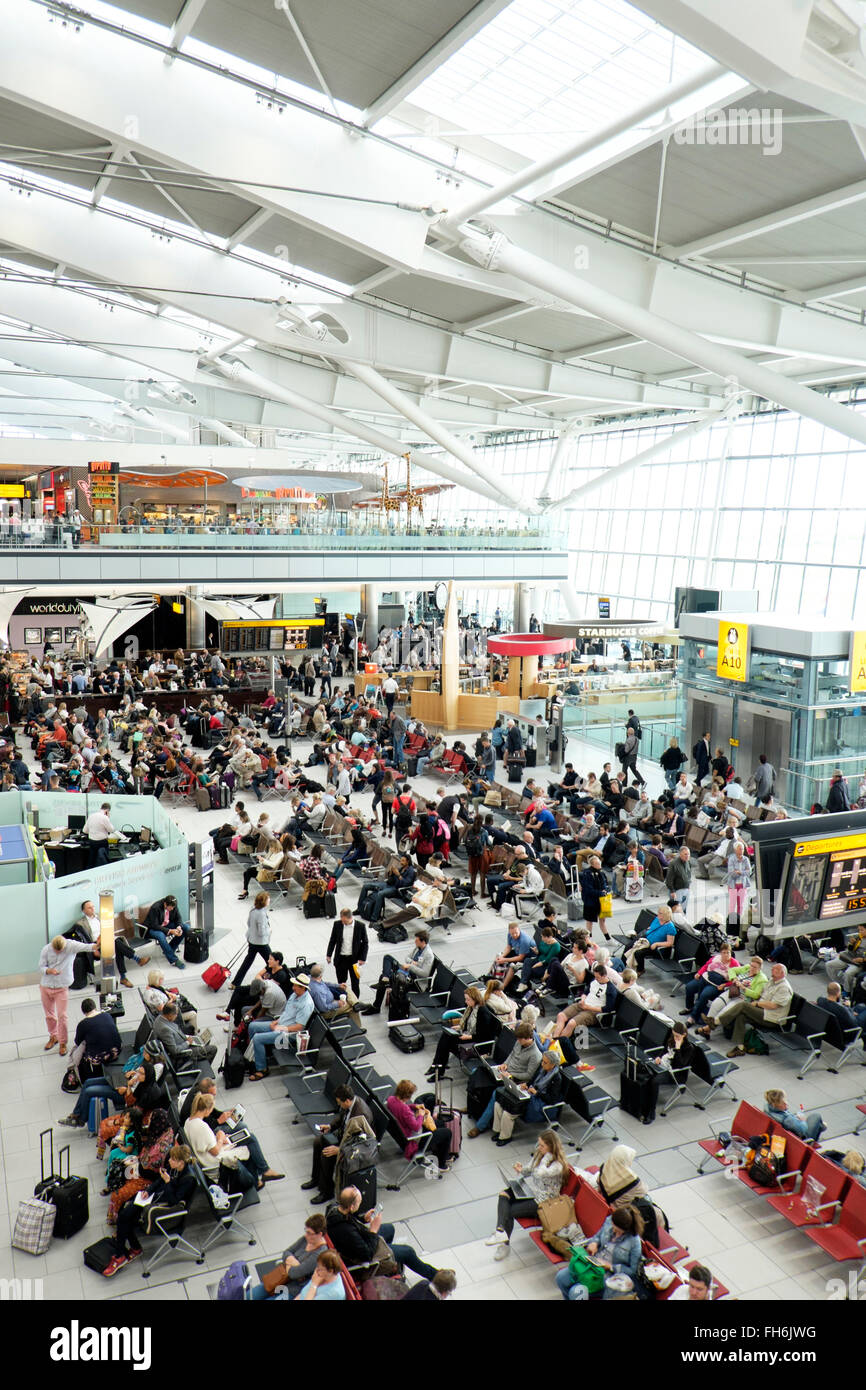 Interior view of London Heathrow Airport Terminal 5, busy with passengers. - Stock Image