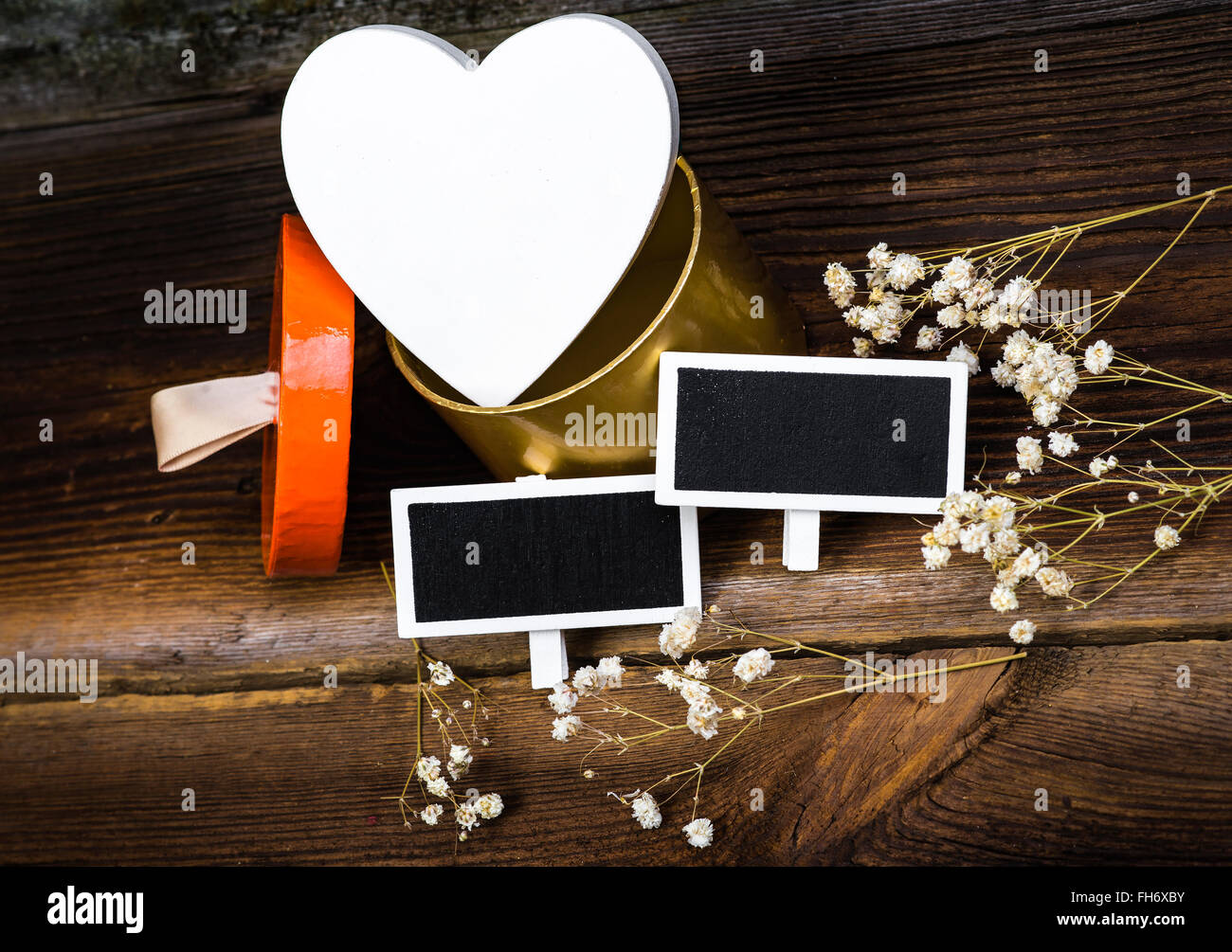 White Wooden Heart In Gift Box, Small Blackboards And White Dried Flowers On Wooden Boards. Romantic Composition. - Stock Image