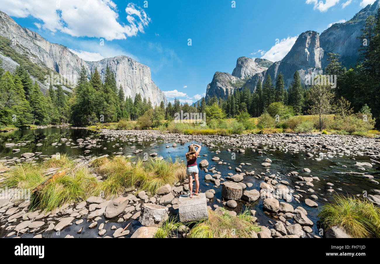 Tourist photographing, Valley View overlooking El Capitan and Merced River, Yosemite National Park, California, - Stock Image