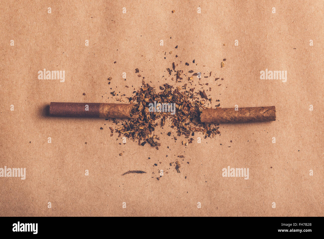 Quit smoking concept, broken cigarette top view, warm retro image tone. - Stock Image