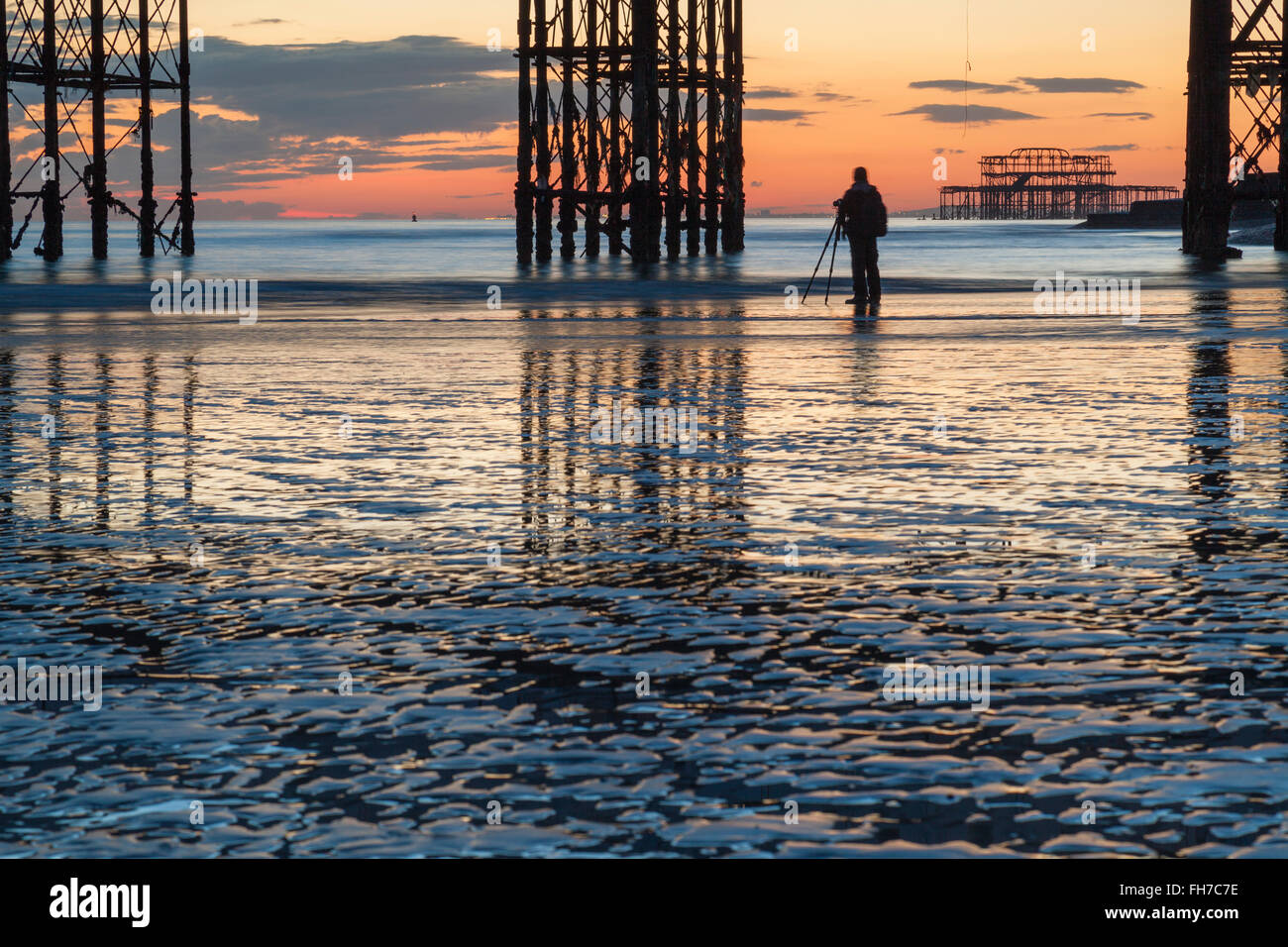Evening on Brighton beach at low tide, UK. - Stock Image