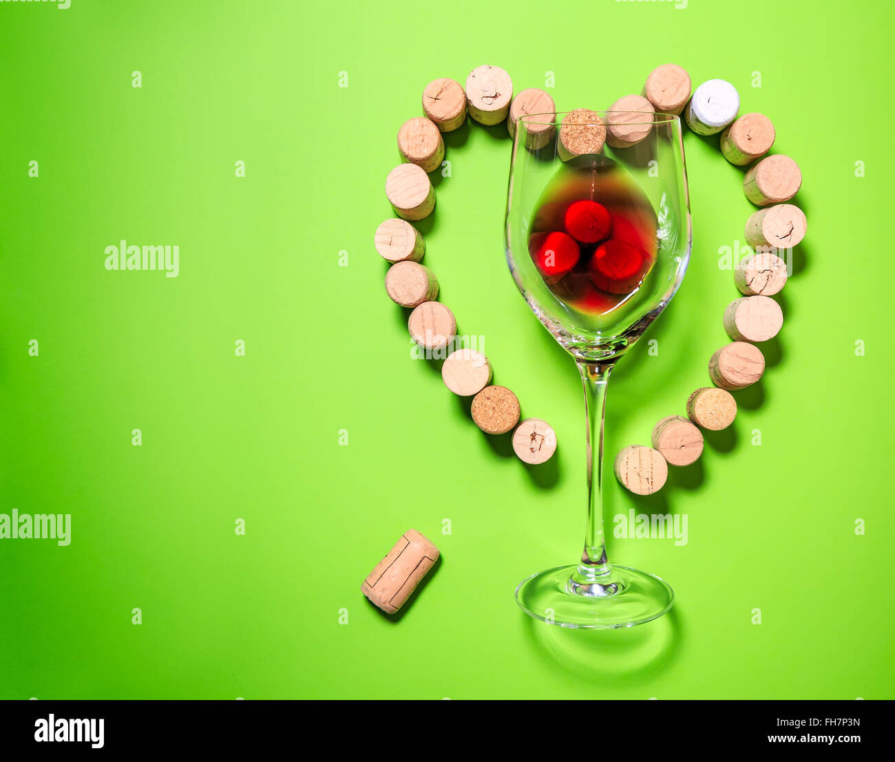 Glass of wine with cork stoppers - Stock Image
