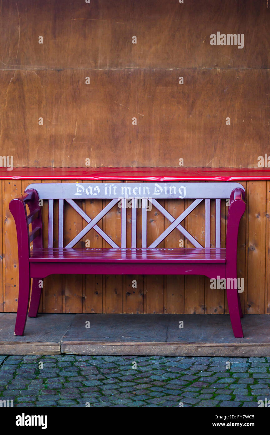 painted wooden bench displaying an inscription: this is my thing - Stock Image