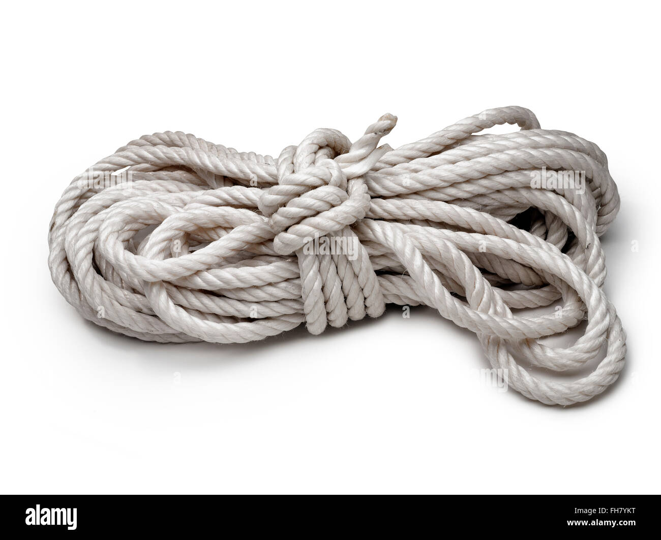 Close-up of twisted rope with white backdrop - Stock Image