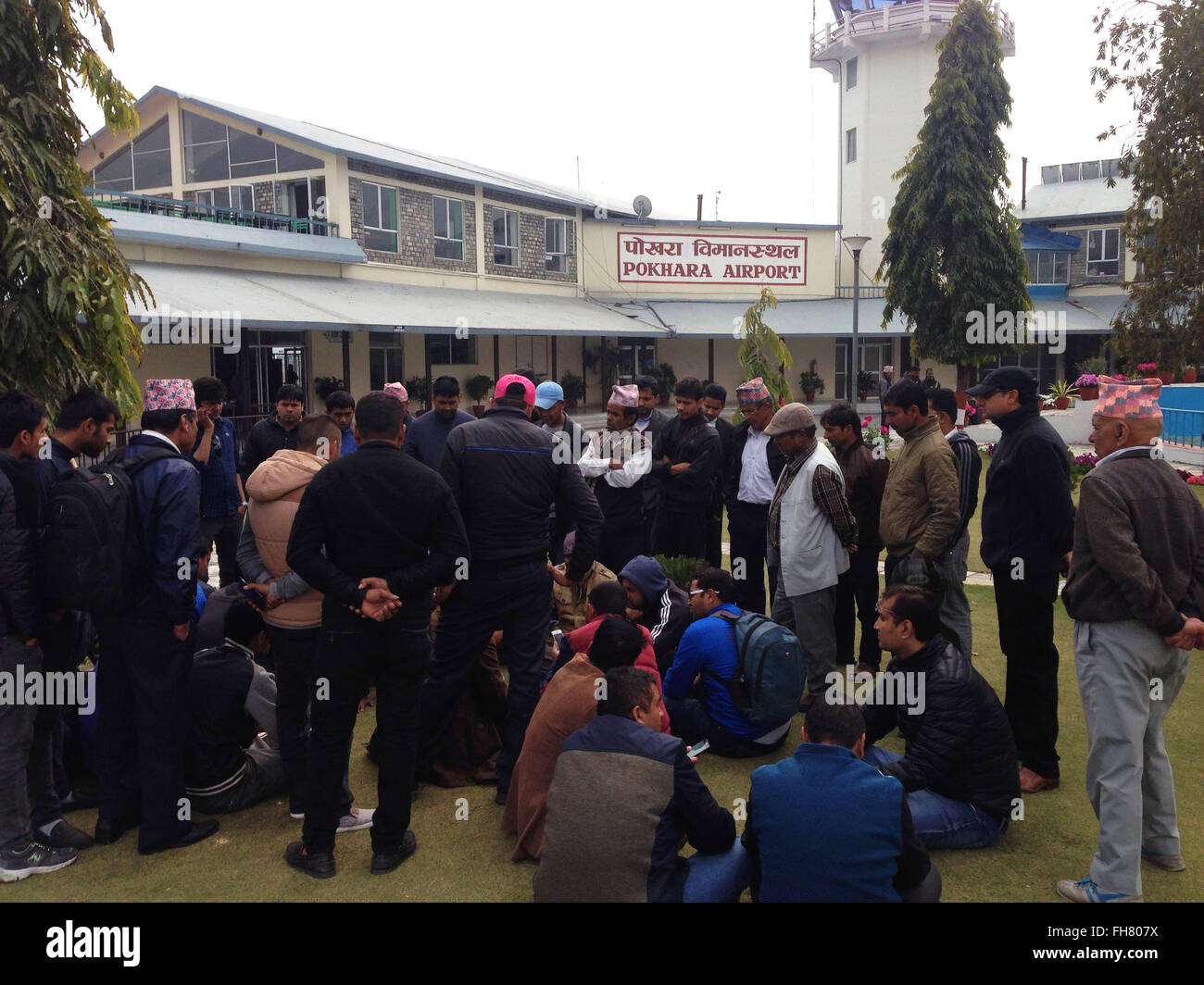Pokhara, Nepal. 24th Feb, 2016. Family members and relatives of the victims gather after hearing the information - Stock Image