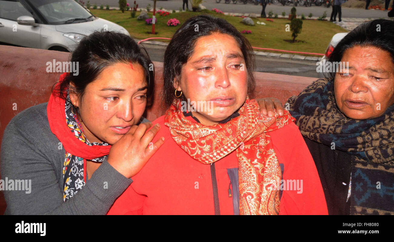 Pokhara, Nepal. 24th Feb, 2016. Family members and relatives of the victims cry after hearing the information about - Stock Image
