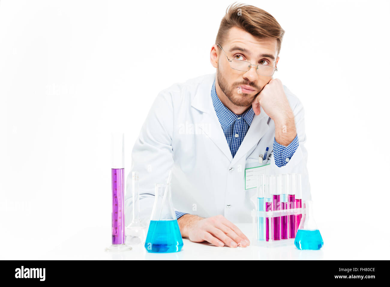 Scientist pouring chemicals isolated on a white background - Stock Image