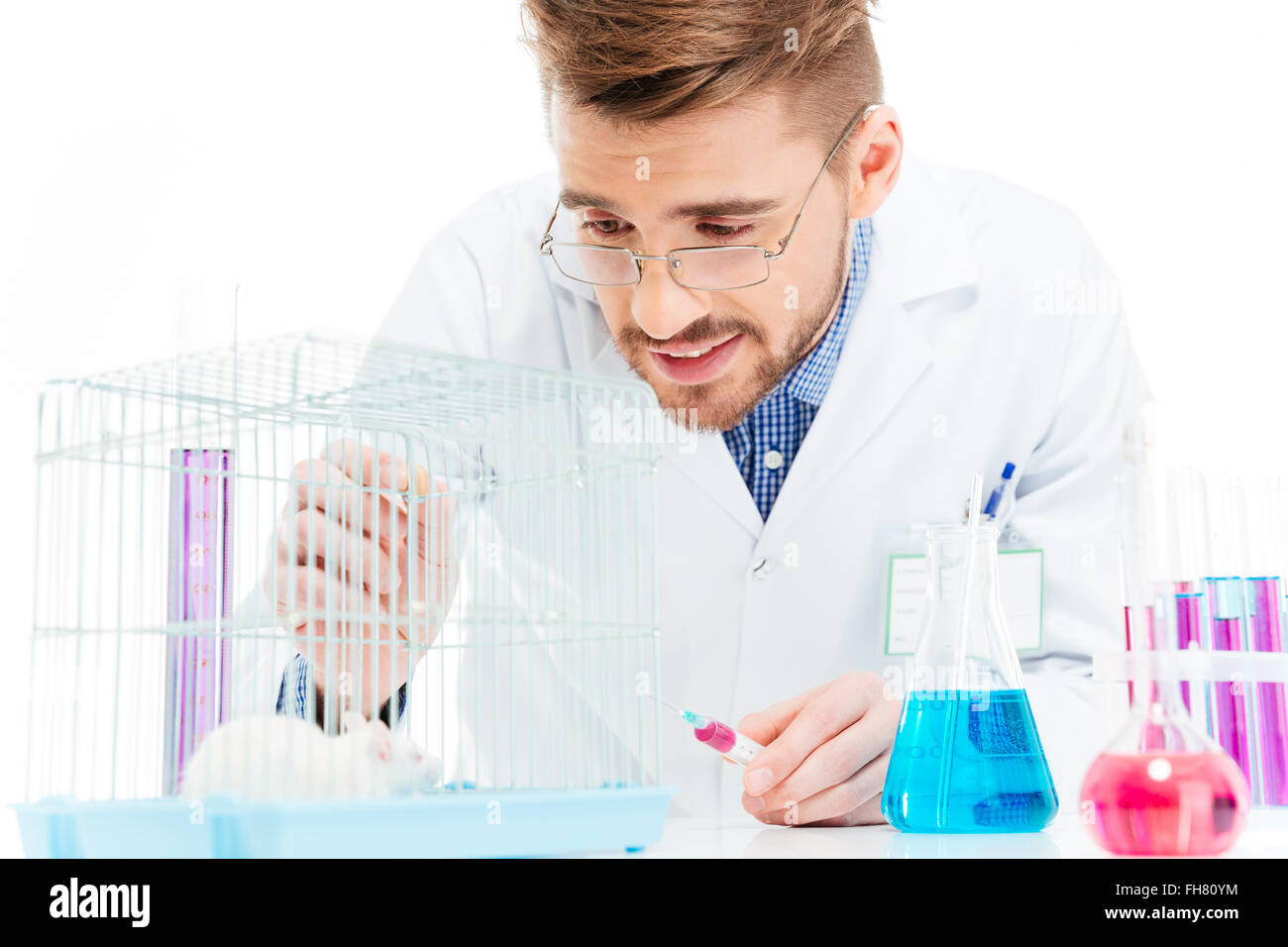 Male scientist doing experiments with rat in a laboratory - Stock Image