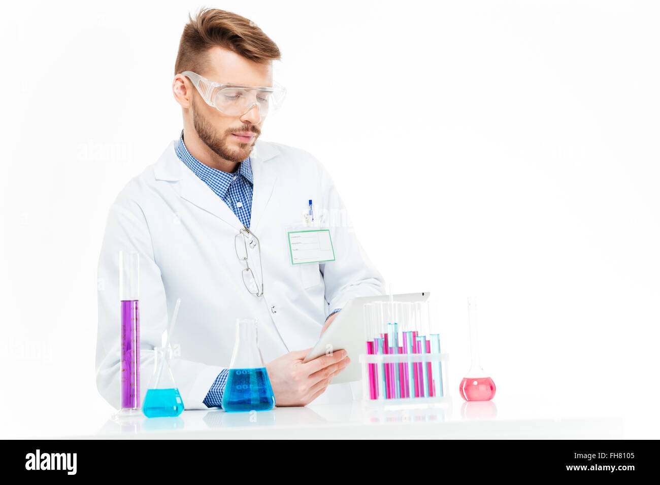 Chemist using tablet computer in laboratory - Stock Image