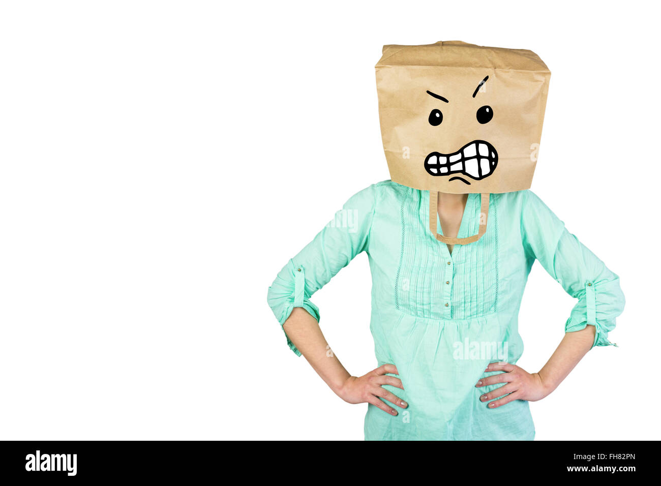 Composite image of woman covering head with brown paper bag - Stock Image