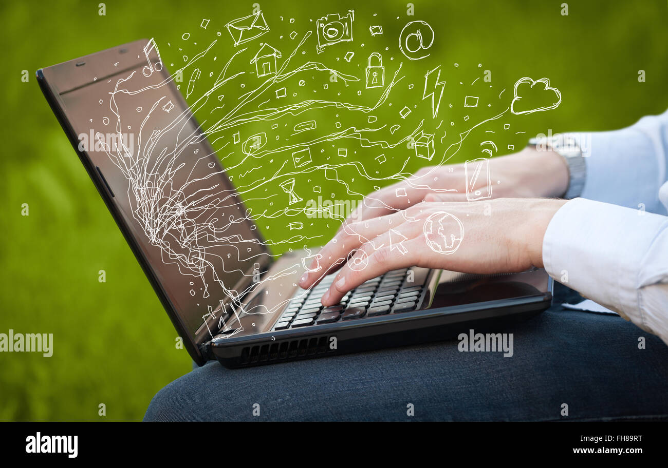Man Pressing Notebook Laptop Computer With Doodle Icon Cloud Symbols