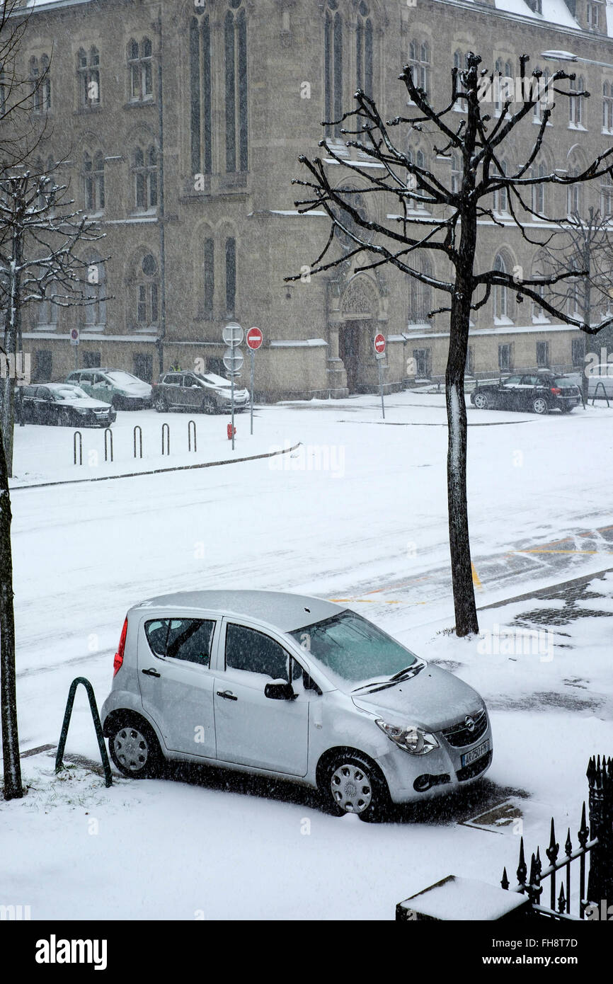 Parked car on pavement and snow in town, Strasbourg, Alsace, France - Stock Image