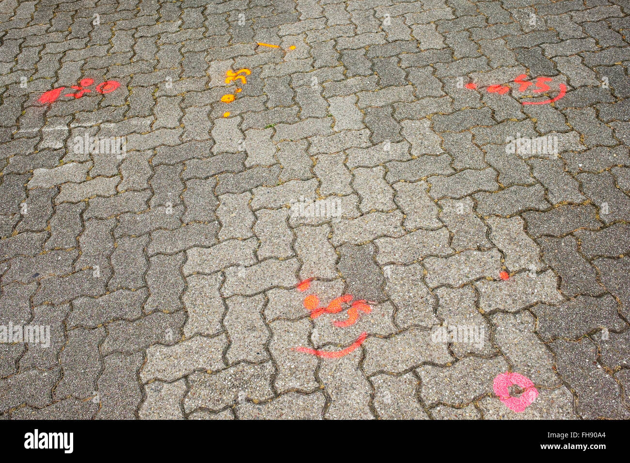 Cobbled pavement with markings before civil engineering, France - Stock Image