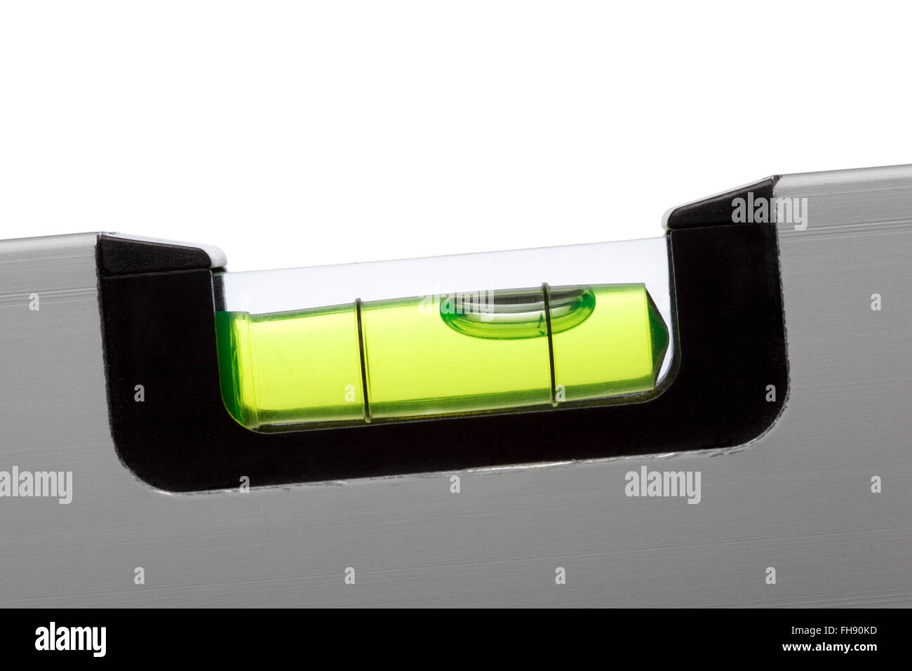 Close up of a water level on white background - Stock Image