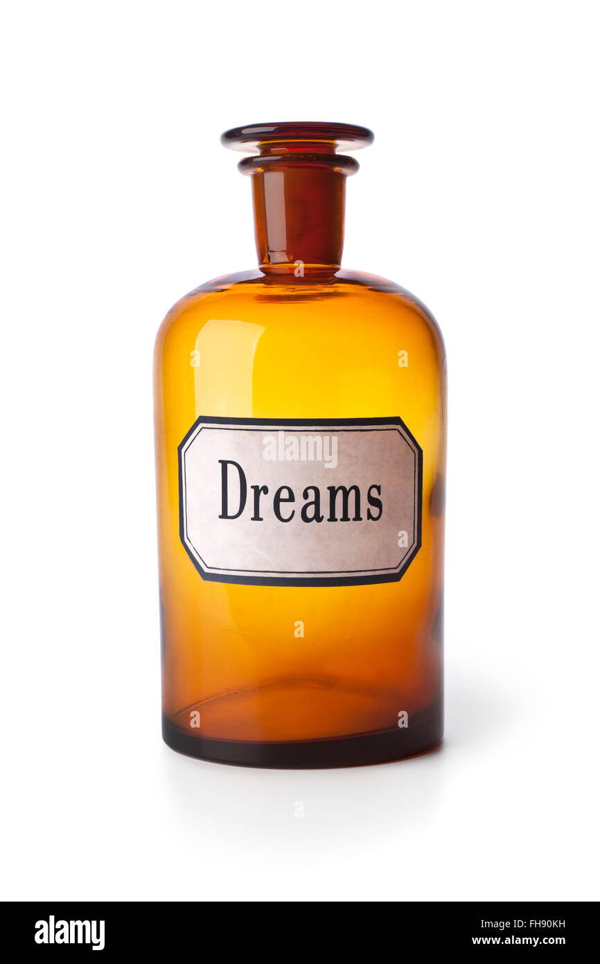 Old brown pharmacy medicine bottle with the word dreams on white background - Stock Image
