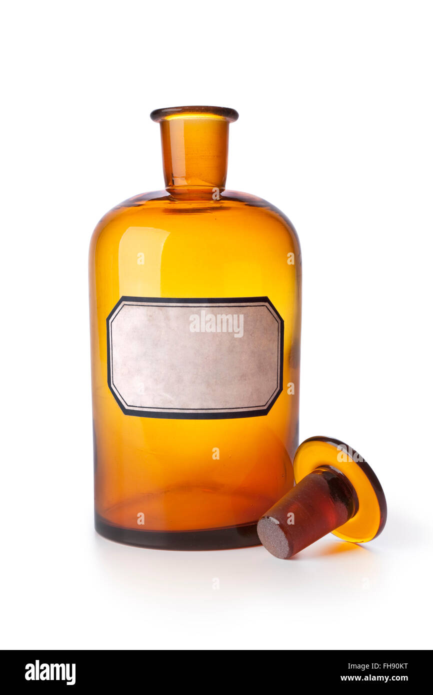 Old brown medicine bottle with an empty label on white background - Stock Image