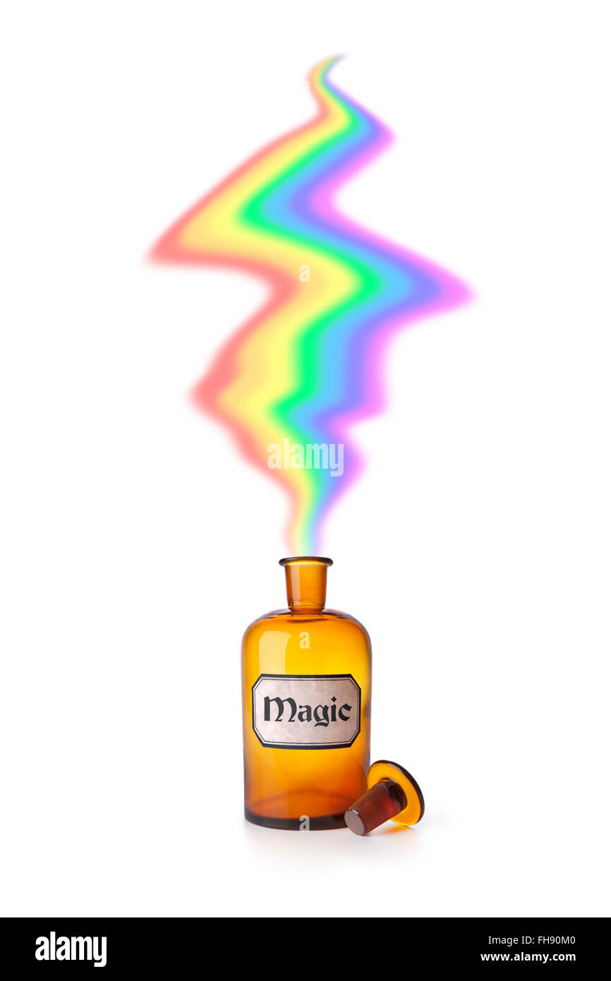 Magic medicine bottle on white background - Stock Image