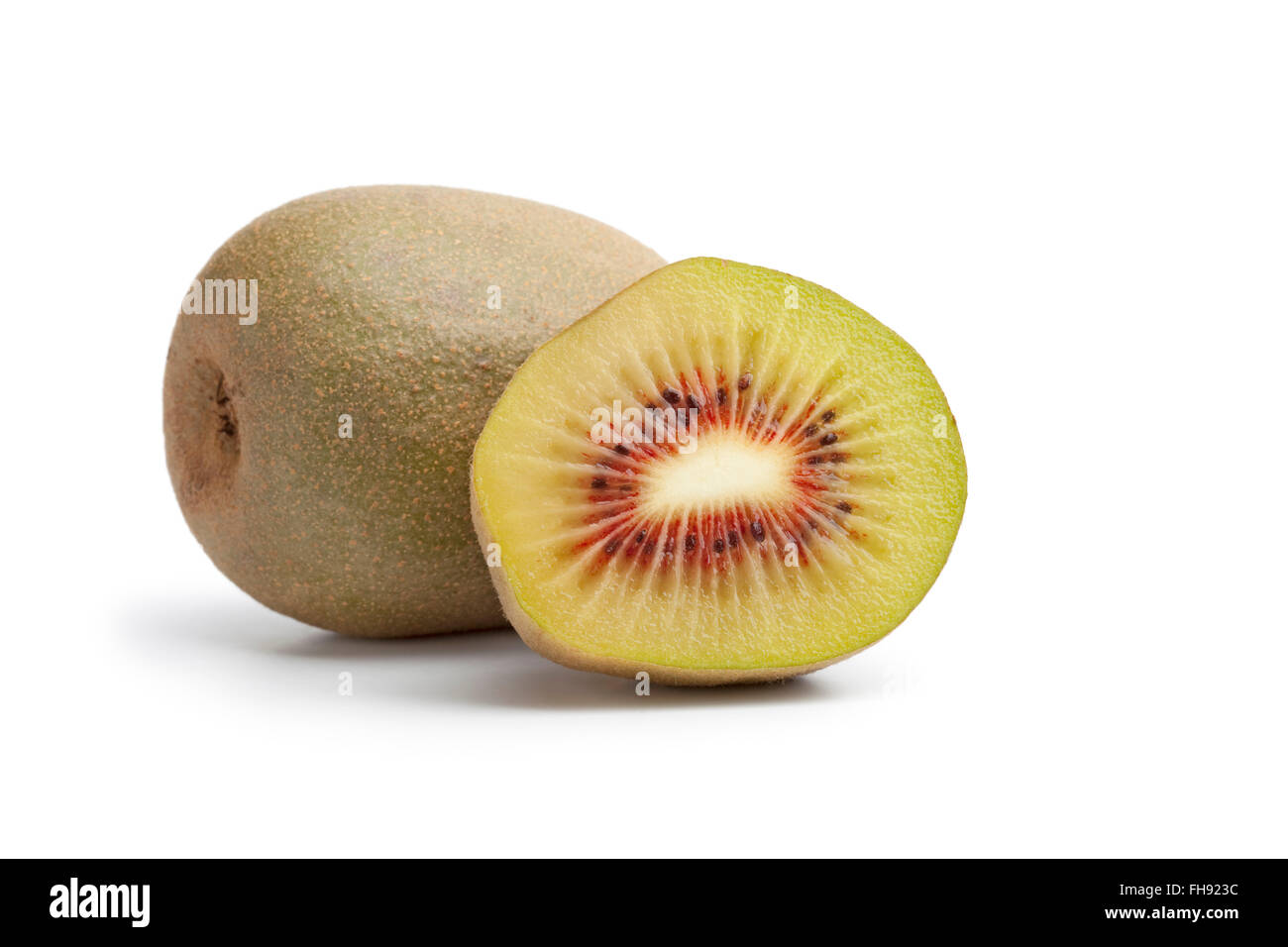 Fresh ripe sweet sun kiwi with a red heart on white background - Stock Image