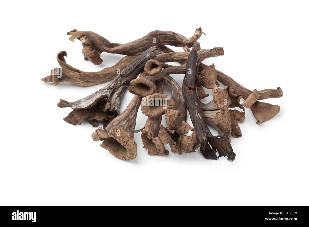Whole fresh raw Horn of Plenty mushrooms isolated on white background - Stock Image
