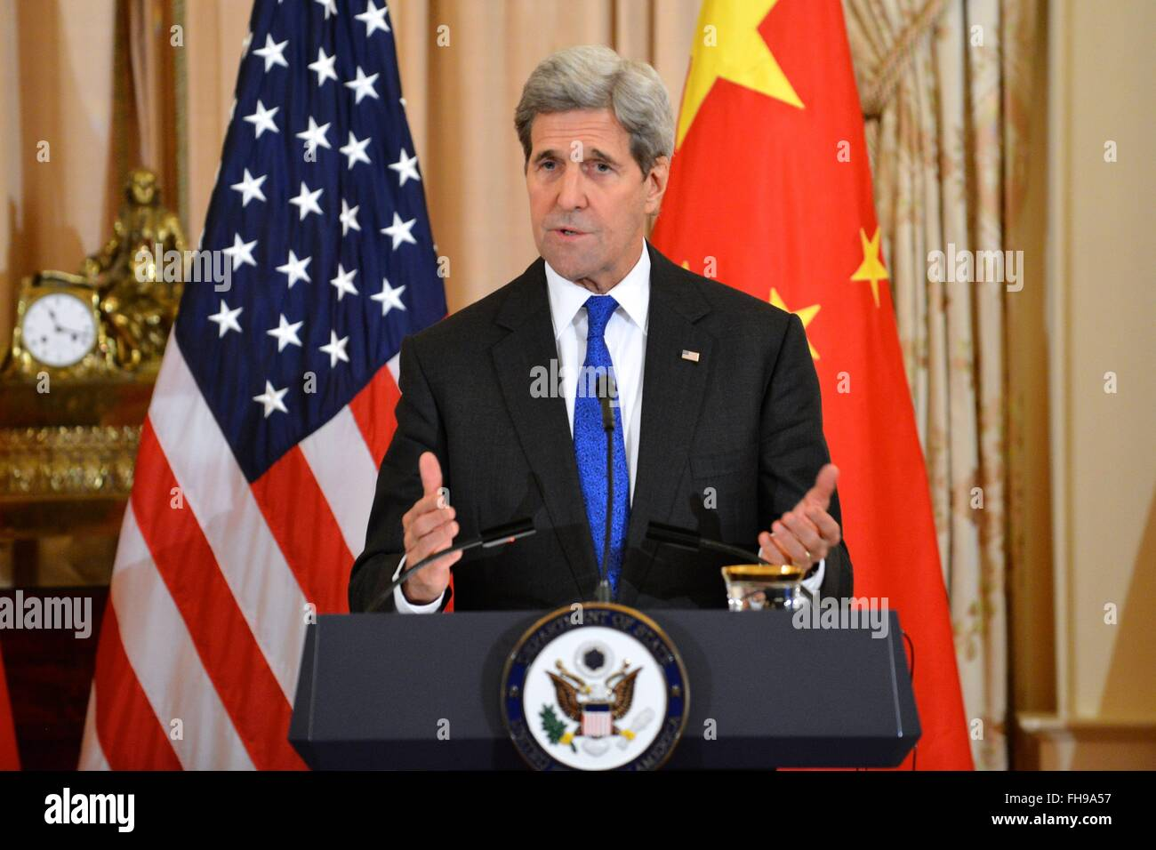 U.S. Secretary of State John Kerry during a joint news conference with Chinese Foreign Minister Wang Yi at the Department - Stock Image