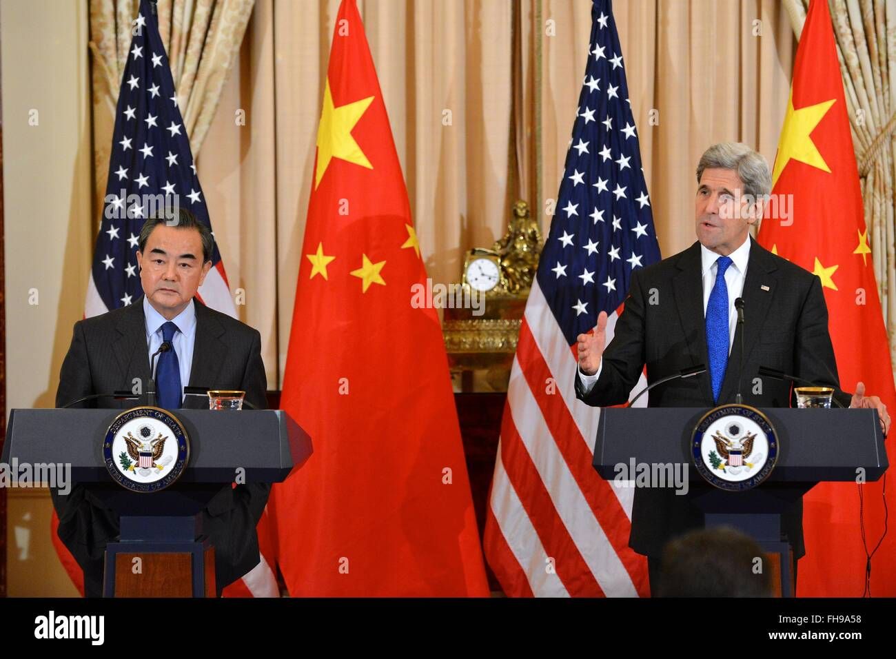 U.S. Secretary of State John Kerry and Chinese Foreign Minister Wang Yi during a joint news conference at the Department - Stock Image