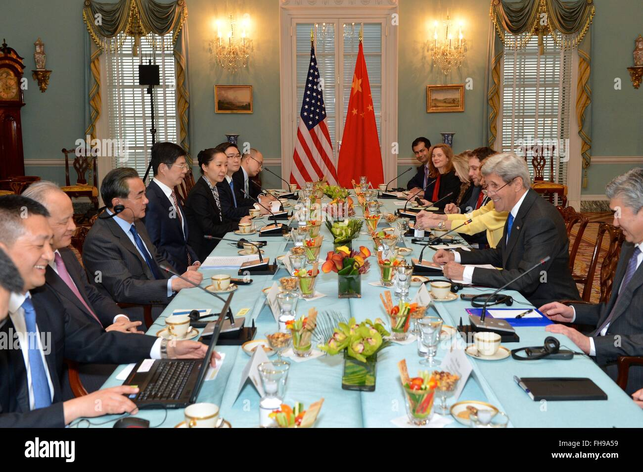 U.S. Secretary of State John Kerry and Chinese Foreign Minister Wang Yi along with their delegation during a bilateral - Stock Image