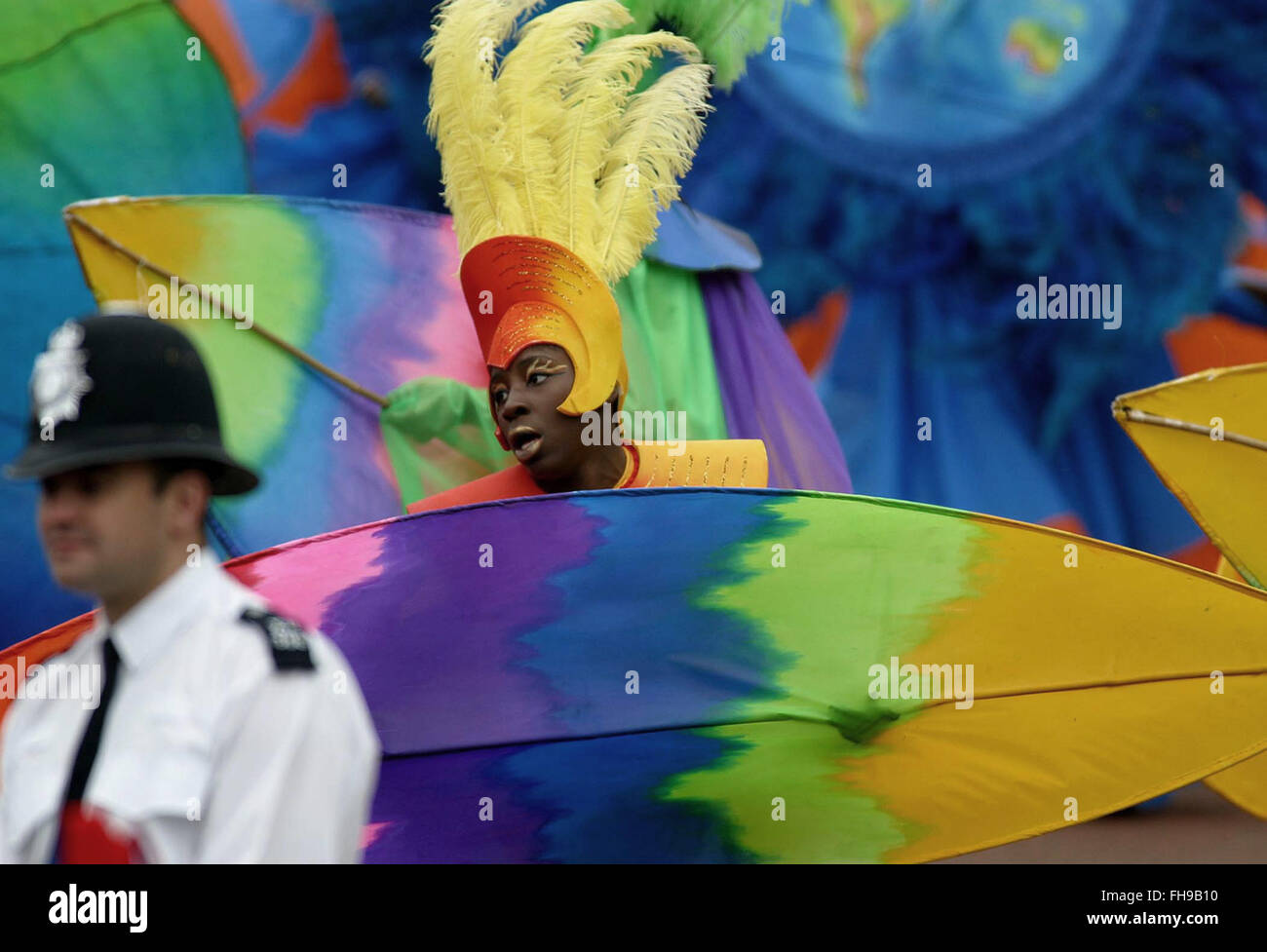 A performer dancing outside Buckingham Palace in a special pageant marking Queen Elizabeth II's Golden Jubilee - Stock Image