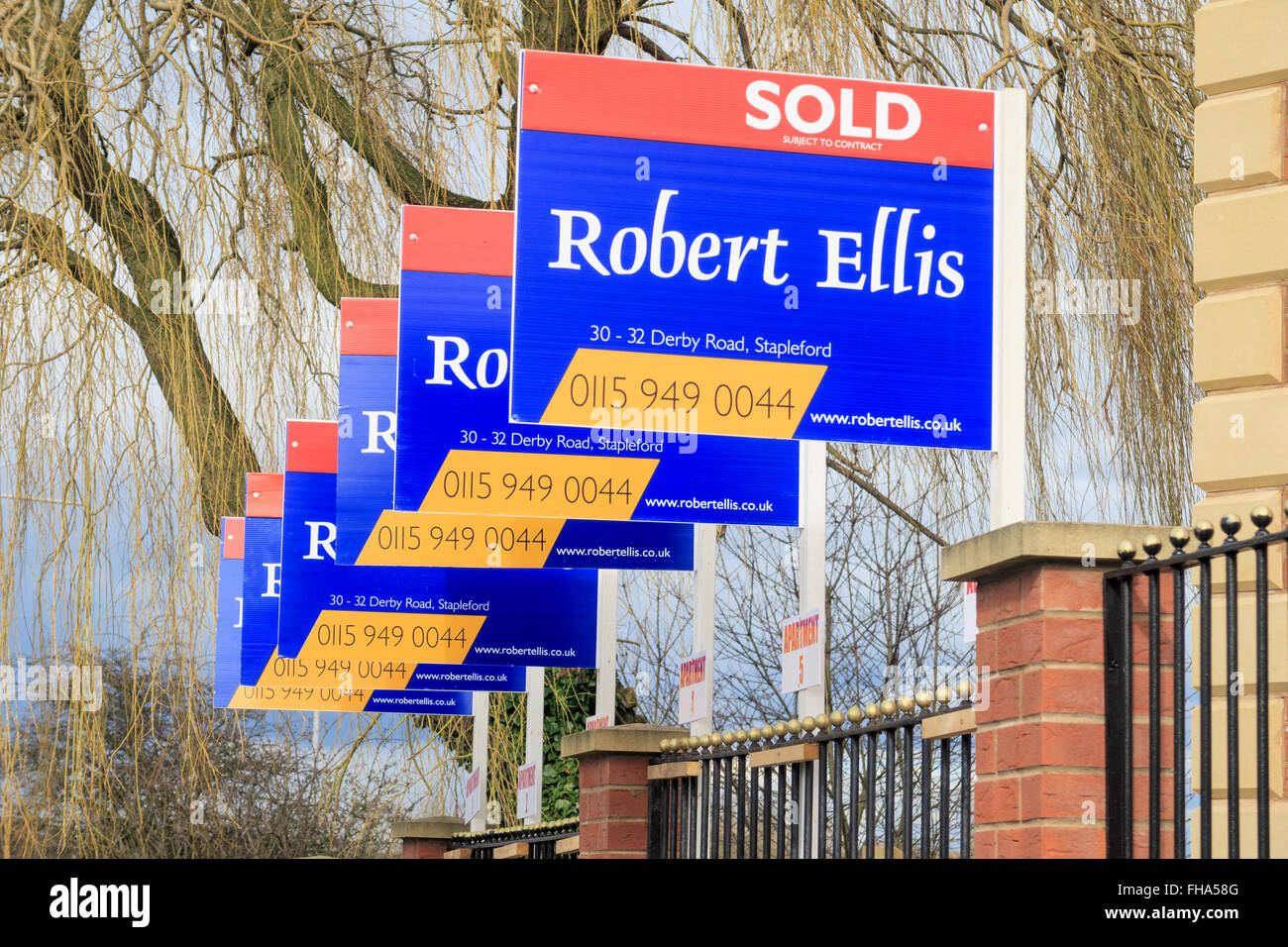 A row of 'Robert Ellis' estate agent house 'sold' signs. In Awsworth, Nottinghamshire, England. - Stock Image